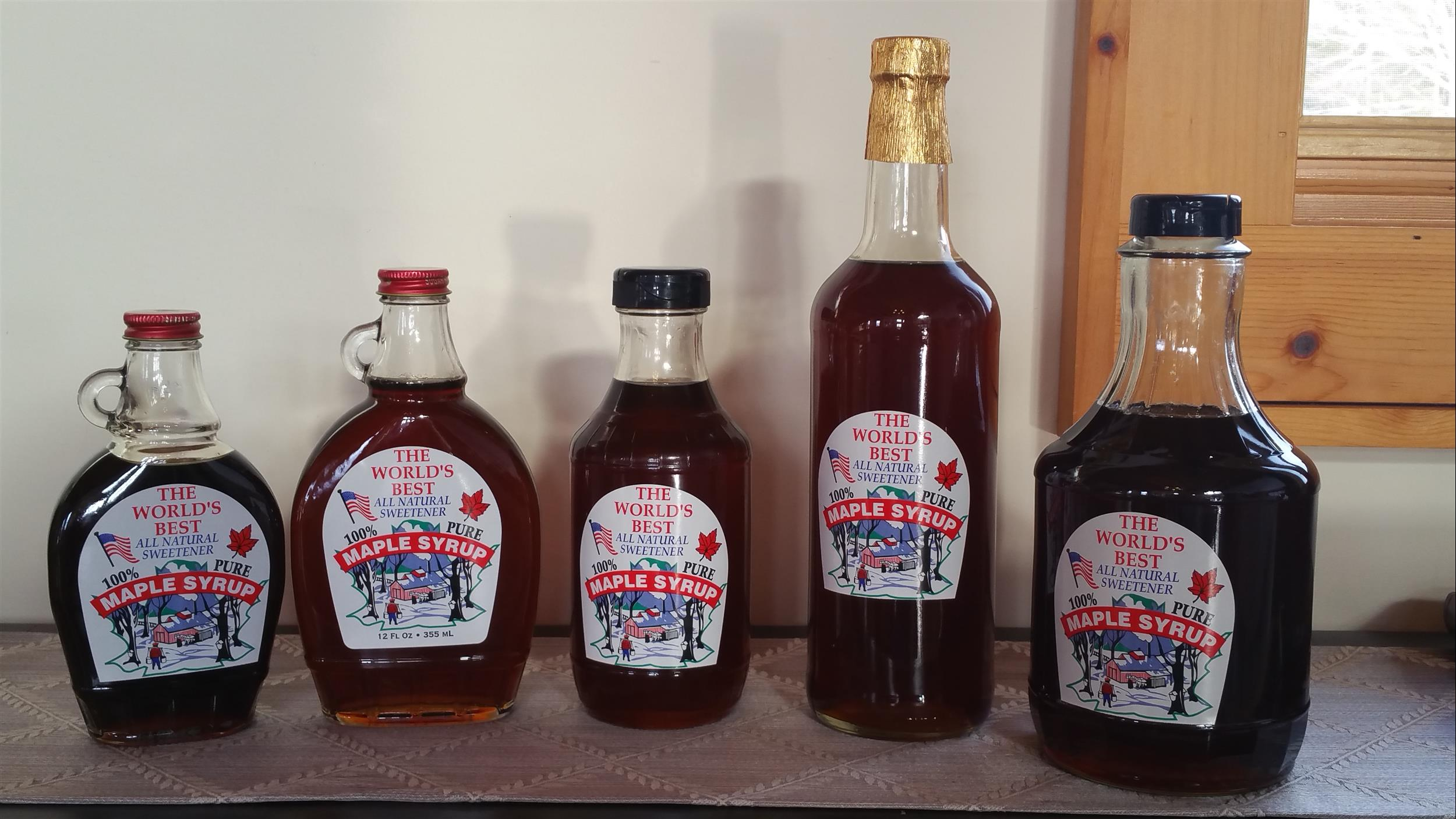 5 glass bottles of Tenwood Lodge Maple syrup